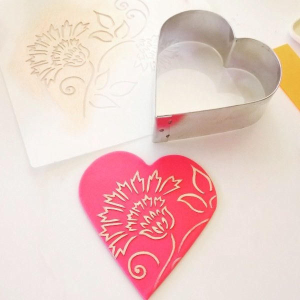 Brushstroke Thistle Flower Cake Stencil used to create a pretty red sugar heart