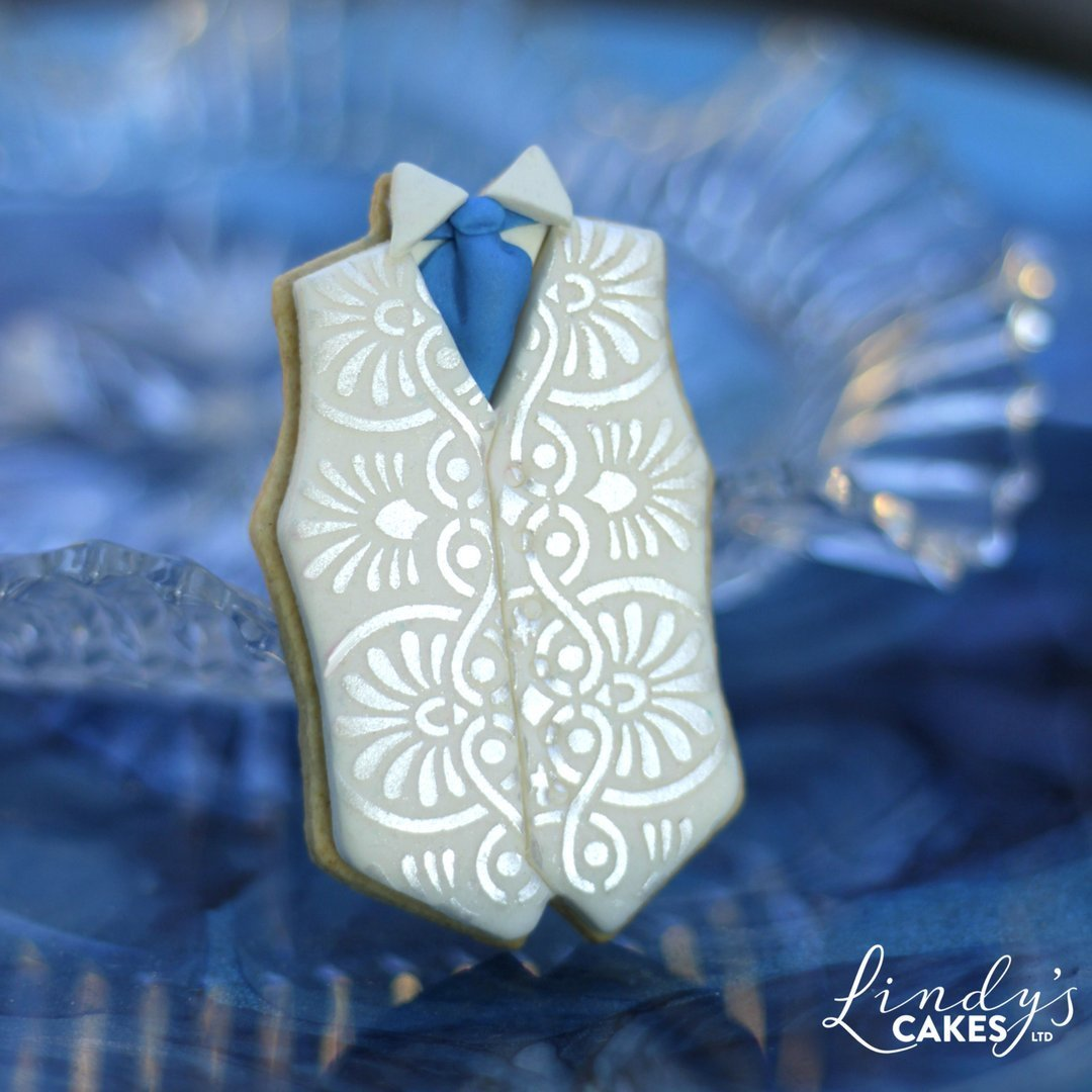 Wedding waistcoat cookie decorated with Lindy's Greek repeat stencil