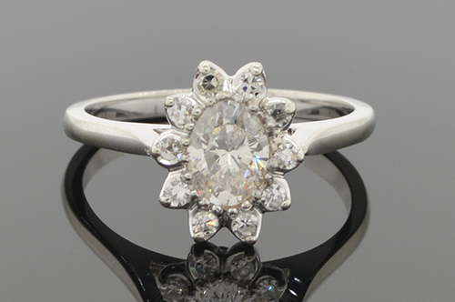 Item #4352 Flower Ring With Oval Diamond Center 4352