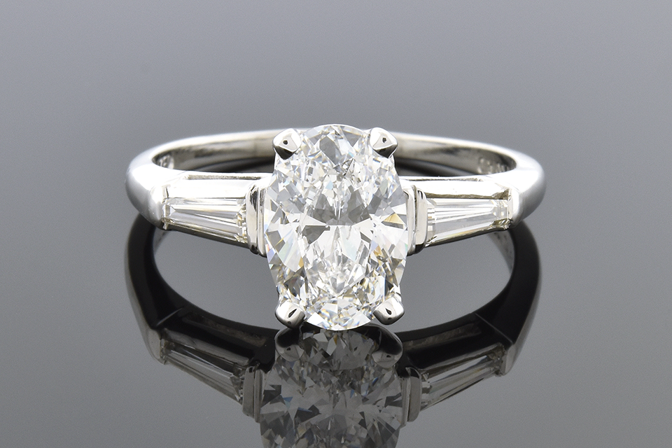 Classic Oval and Baguette Diamond Engagement Ring
