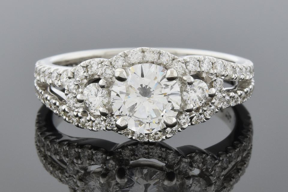 Three Stone Engagement Ring with Diamond Trim