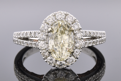Item #6512 Oval Diamond Halo Engagement Ring with a Split Shank Design