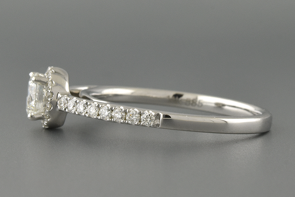Understated Diamond Halo Engagement Ring