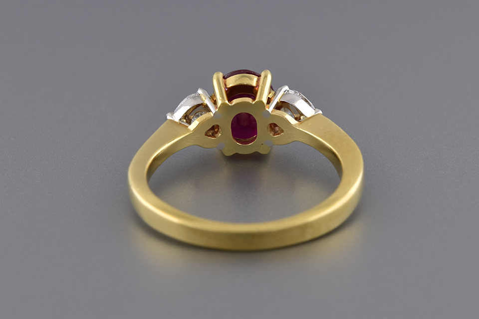 Ruby Ring with Heart Shaped Side Diamonds