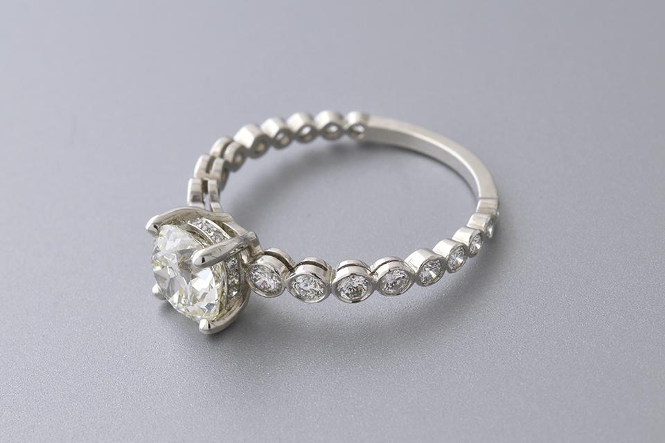 1.21 Carat Diamond Engagement Ring with Bezel Set Shank