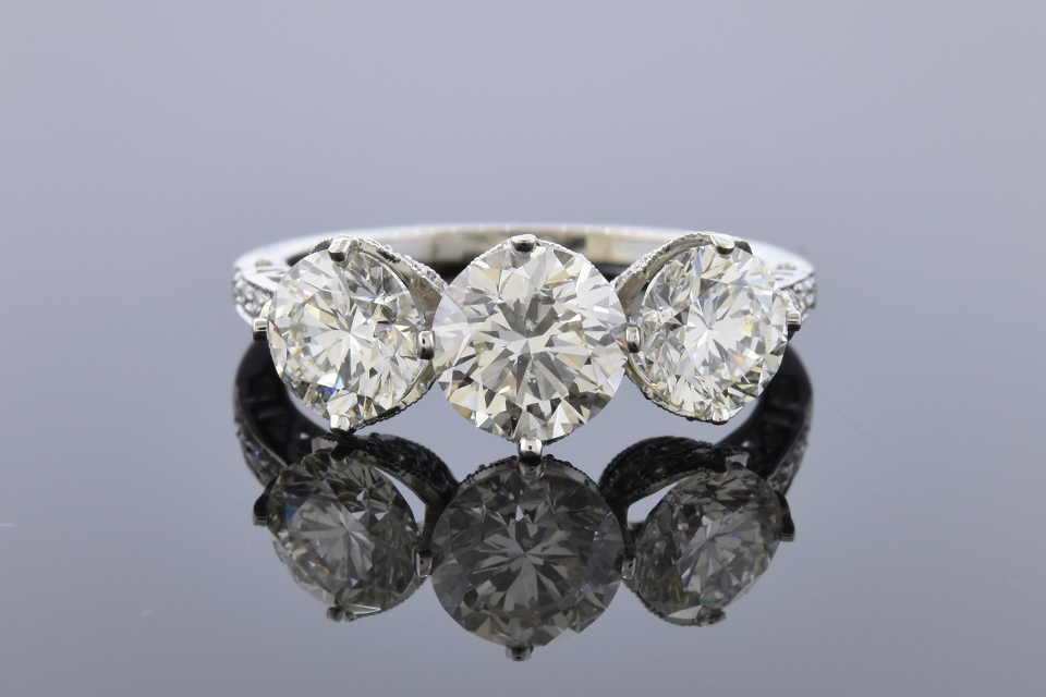 Item #10231 Three Stone Diamond Ring with Open Design Details 10231