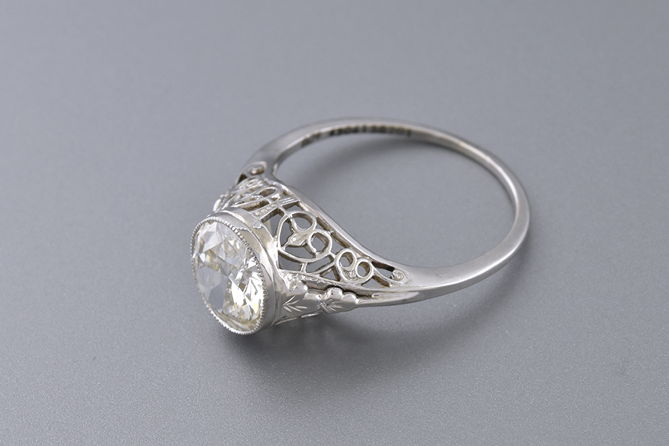 Art Deco Filigree Ring with a Vintage Cut Diamond