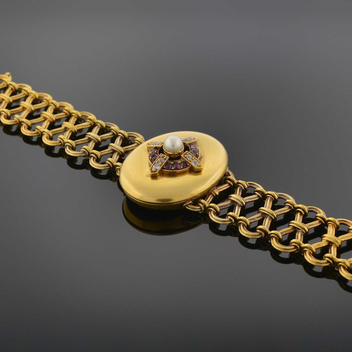 Late Archaeological-Revival Gold, Ruby, and Diamond Bracelet