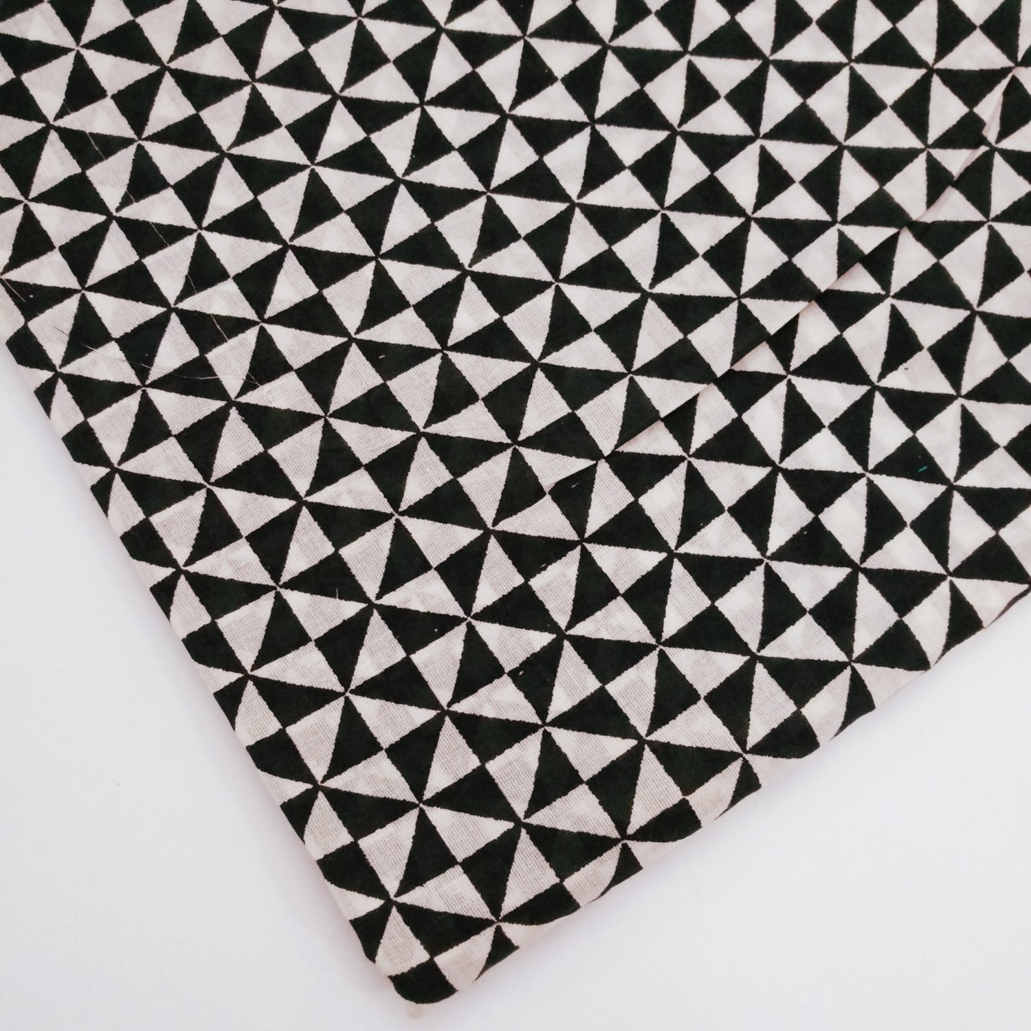 Black and white pinwheel fabric sold by half meter