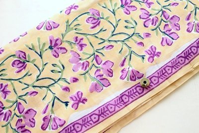 Purple Floral Block Print cotton fabric on biscuit color background