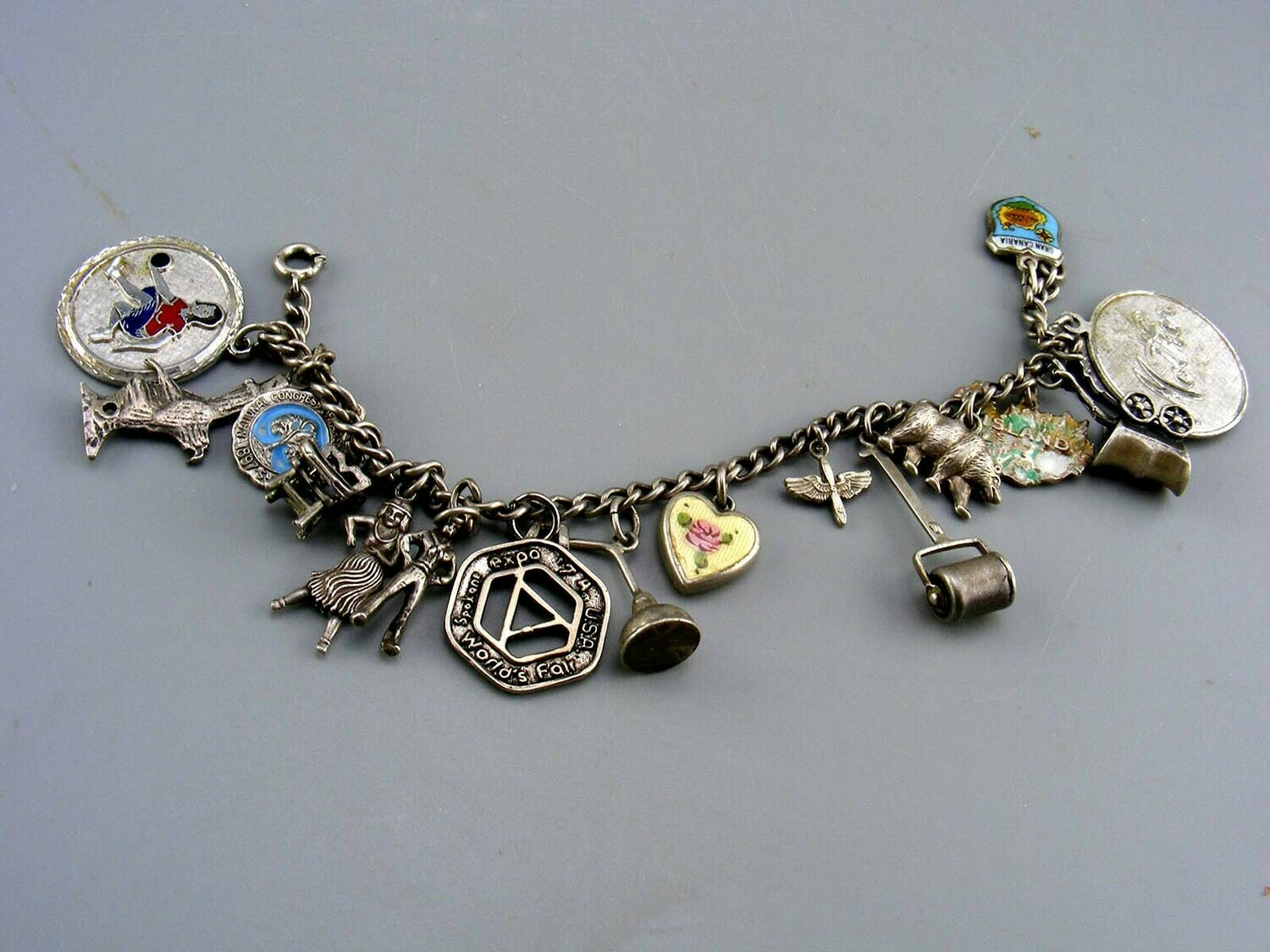 Vintage Sterling Silver Bracelet with 17 charms