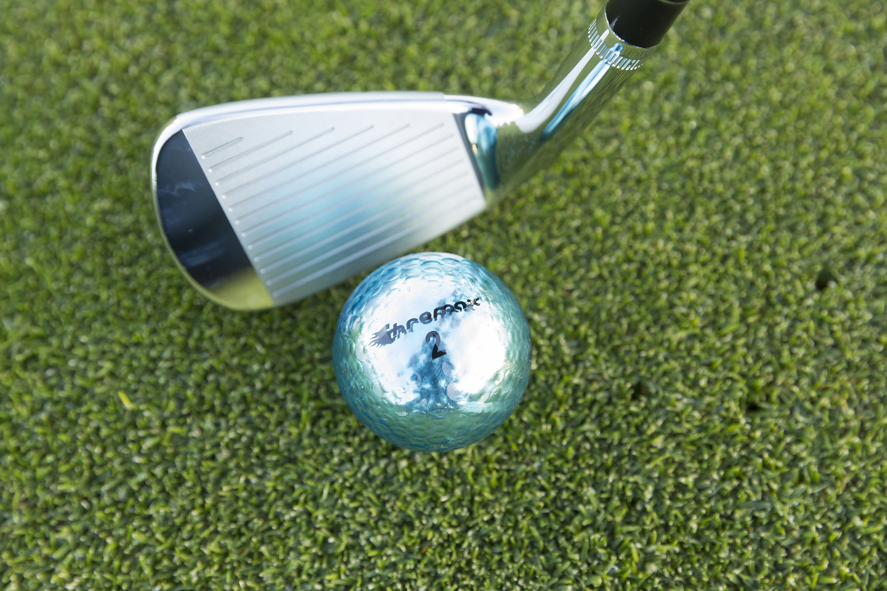 Chromax blue golf ball with wedge