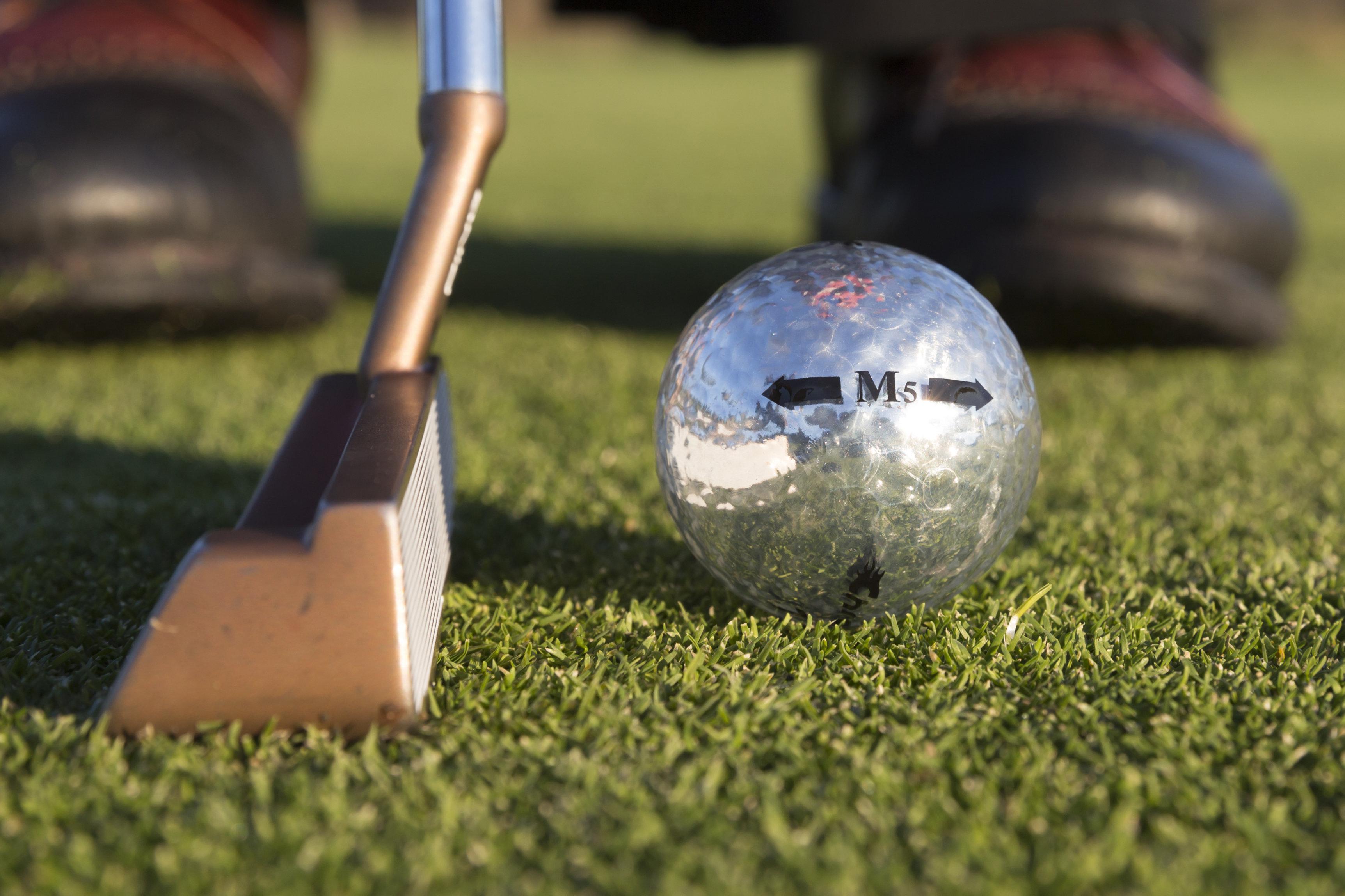 Chromax silver golf ball M5 putting