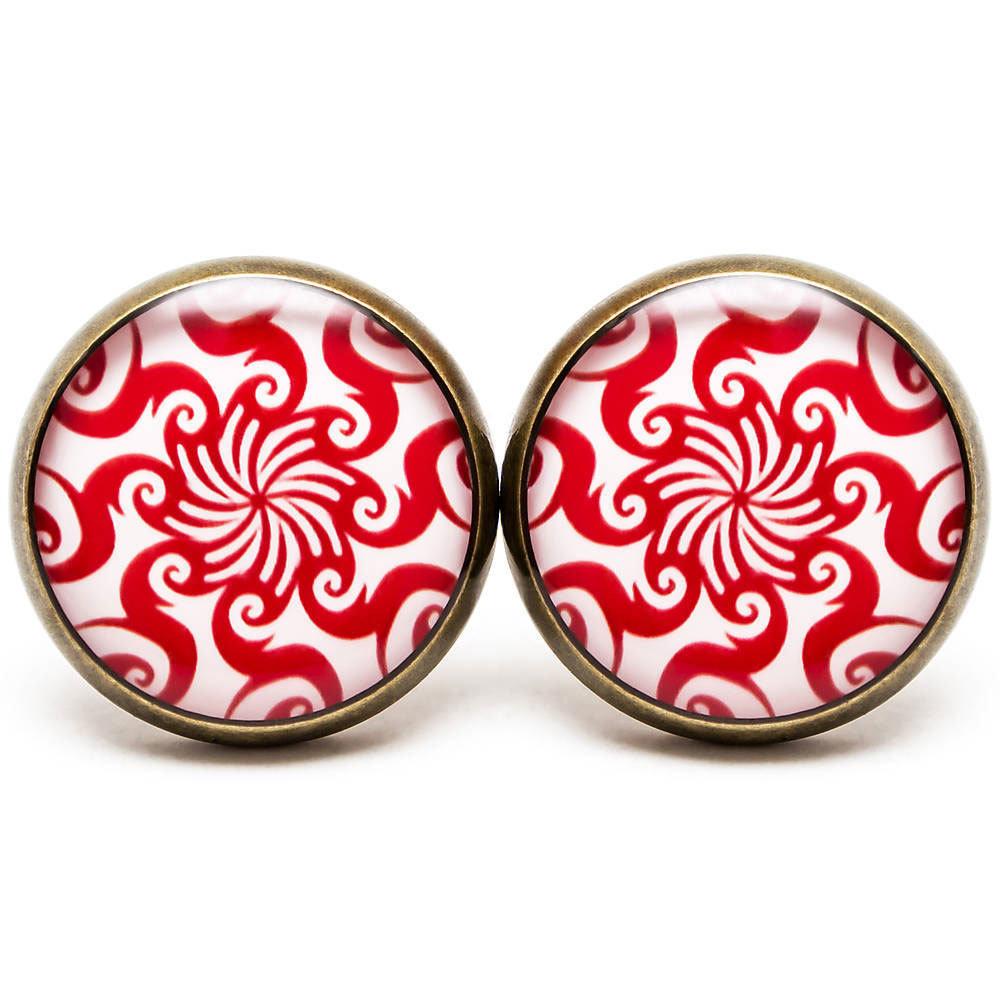 Tribal spiral sun - red